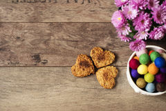 Heart shaped cookies. Top view of homemade cookies, flower chrysanthemum and colorful marbles. Healthy dessert with cinnamon Stock Photography