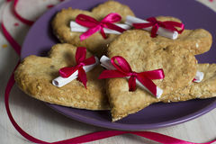 Heart-shaped cookies for Valentines Day. Edible surprise for lovers. The oatmeal cookies with letter Royalty Free Stock Photo