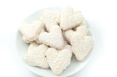 Heart shaped cookies with white chocolate with coconut on a plat Royalty Free Stock Photo