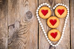 Heart shaped cookies on wooden table stock photos