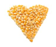Heart Shaped Corn. Raw Yellow Popcorn Kernels made into the shape of a heart to show the heart healthy feel of corn royalty free stock images