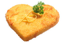 Heart shaped crumbed escalope stock photography