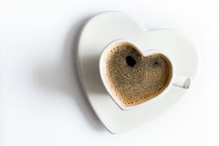 Heart shaped cup of black coffee on white. Love Royalty Free Stock Photography
