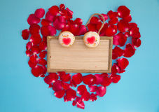 Heart shaped cupcake and red rose with wooden board Royalty Free Stock Images