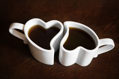 Heart shaped cups of coffee Stock Image