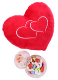 Heart shaped cushion with candy Stock Photography