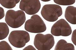 Heart-shaped dark chocolate candies Royalty Free Stock Photos