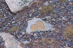 Heart shaped design. Made from stone, background Stock Photo