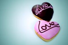 Heart-shaped dessert writing love Stock Images