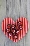Heart-shaped dish with brownie cupcakes for Valentine's day Stock Photography