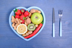 Heart shaped dish with vegetables  Royalty Free Stock Images