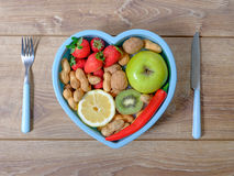 Heart shaped dish with vegetables  Stock Images