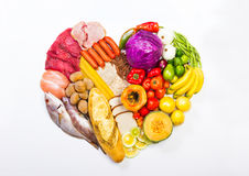 Heart shaped display of foods stock photography