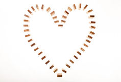 Heart Shaped Domino Rally Falling. Royalty Free Stock Photo