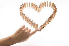 Heart Shaped Domino Rally Falling. Stock Image