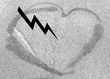 Heart shaped drawing on asphalt, love concept. lightning in the heart. Heart shaped drawing on asphalt, love concept. Heart drawn on the pavement royalty free stock photography