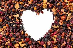 Heart shaped of dry hibiscus petals and berries on white background. royalty free stock image
