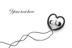 Heart-shaped earphones Stock Image