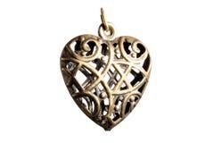 Heart Shaped Earring. Heart shaped hollow bronze earring with celtic type pattern Stock Photo