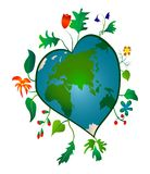 Heart-shaped Earth. With flowers and leaves Royalty Free Stock Photo
