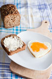 Heart shaped egg on breakfast Stock Photography