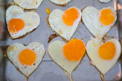 Heart shaped egg cooking Royalty Free Stock Images