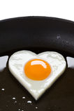 Heart shaped egg in a frying pan Stock Photography