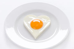 Heart shaped egg on a plate Stock Photo