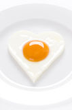 Heart shaped egg on a plate Stock Images