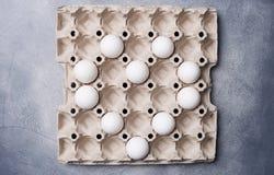 Heart shaped eggs in egg carton box stock image