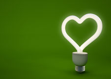 Heart shaped energy saving light bulb Stock Image