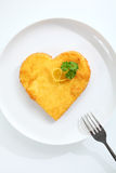 Heart shaped escalope of veal in breadcrumbs Royalty Free Stock Images