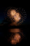 Heart shaped Fireworks. Reflected on water Stock Images