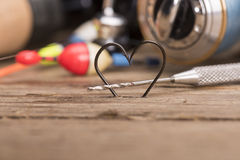 Heart shaped fishing hooks Royalty Free Stock Images