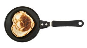 Heart shaped flapjack pancake in a pan Royalty Free Stock Photo