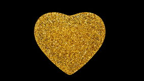 Heart shaped by flying glitters. With alpha channel. stock video