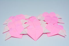 Heart-shaped fold. Of colored paper royalty free stock image