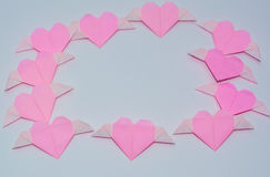 Heart-shaped fold. Of colored paper Stock Photos