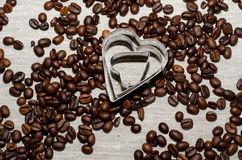 Heart shaped forms for cookies in coffee beans Stock Photo