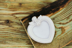 Heart shaped frame with angel stock photos
