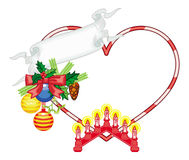 Heart-shaped frame with Christmas decorations and light candle arch. Royalty Free Stock Photo