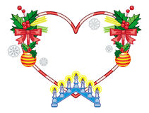 Heart-shaped frame with Christmas decorations and light candle arch Stock Photos