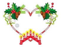 Heart-shaped frame with Christmas decorations and light candle arch. Stock Images