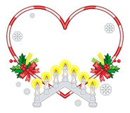 Heart-shaped frame with Christmas decorations and light candle arch Royalty Free Stock Photo