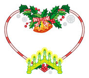Heart-shaped frame with Christmas decorations and light candle arch. Stock Image