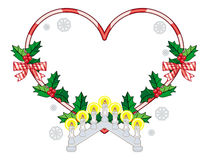Heart-shaped frame with Christmas decorations and light candle arch. Royalty Free Stock Images