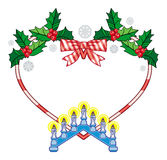 Heart-shaped frame with Christmas decorations and light candle arch. Stock Photo