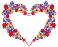 Heart-shaped frame with decorative flowers. Royalty Free Stock Photo
