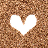 Heart shaped frame made of buckwheat Royalty Free Stock Image