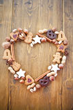 Heart-shaped frame made of cookies and nuts for ch Stock Photo